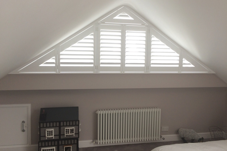 Bedroom shutters for triangular windows: modern  by Plantation Shutters Ltd, Modern Wood Wood effect