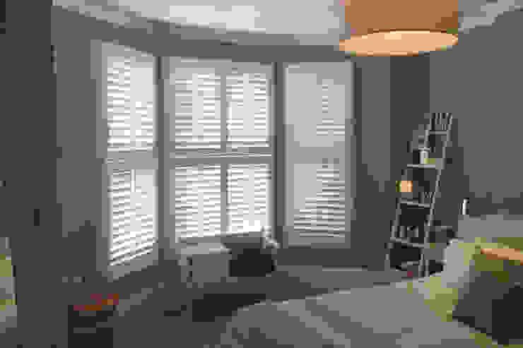 Tier on tier shutters for bedroom windows: modern  by Plantation Shutters Ltd, Modern Wood Wood effect