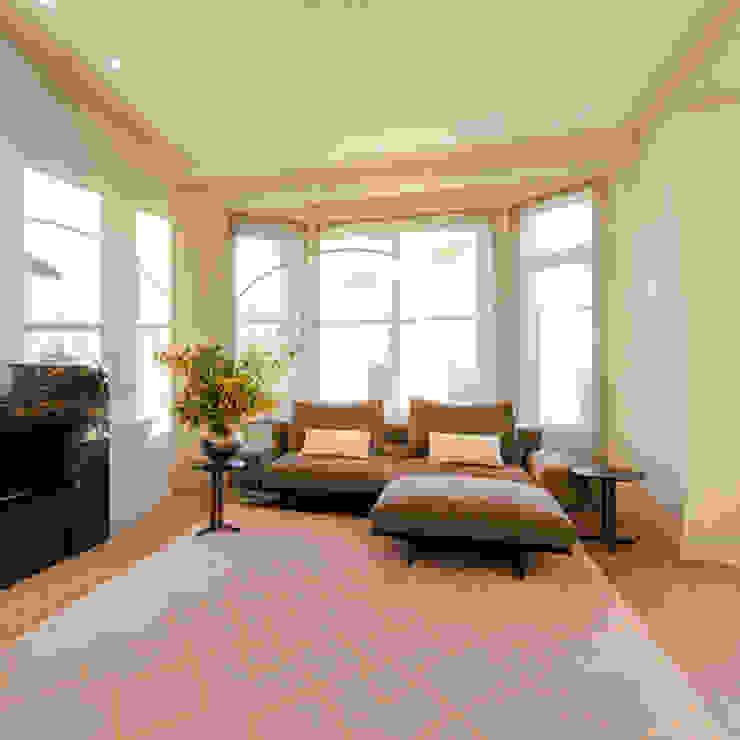 View of bay window and new sofa: modern  by Studio 29 Architects ltd, Modern Wool Orange