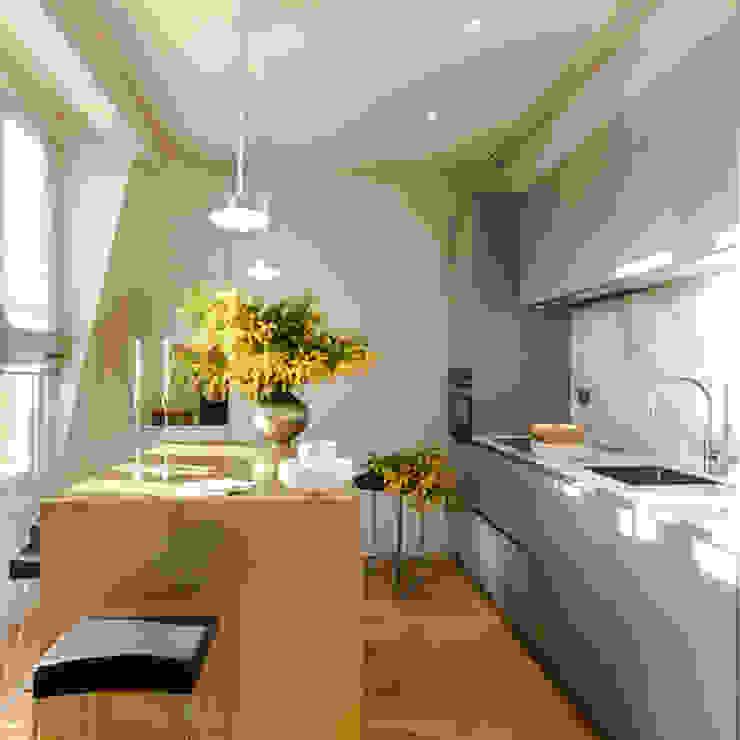 View of kitchen area including island Modern kitchen by Studio 29 Architects ltd Modern Metal