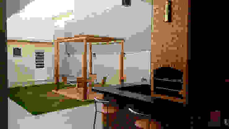 Сад в стиле модерн от Fávero Arquitetura + Interiores Модерн