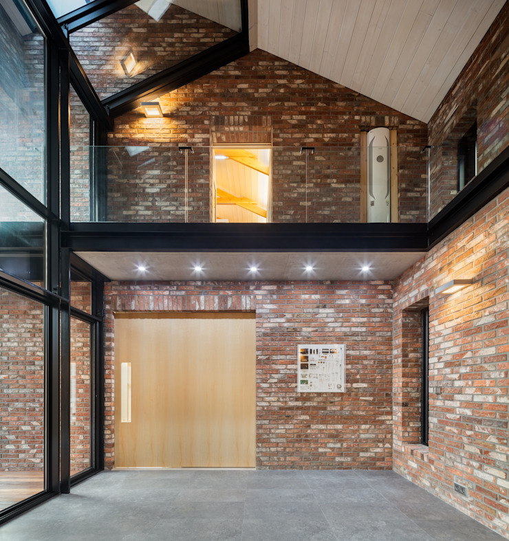 1층 선룸 모던스타일 거실 by (주)건축사사무소 모도건축 모던 벽돌