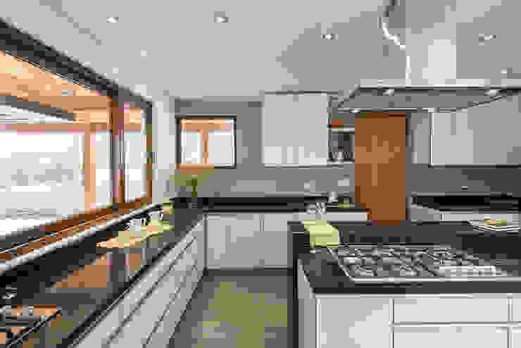 Casa Los Morros: Cocinas de estilo  por Grupo E Arquitectura y construcción