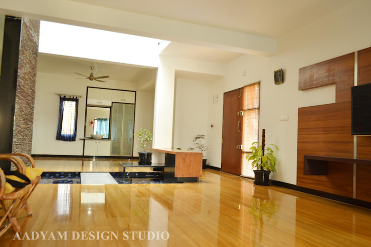 Living and Dining connected by bridge with water body Minimalist living room by Aadyam Design Studio Minimalist