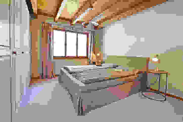 Ferienhaus Laax (CH) Dr. Schmitz-Riol Planungsgesellschaft mbH Schlafzimmer im Landhausstil