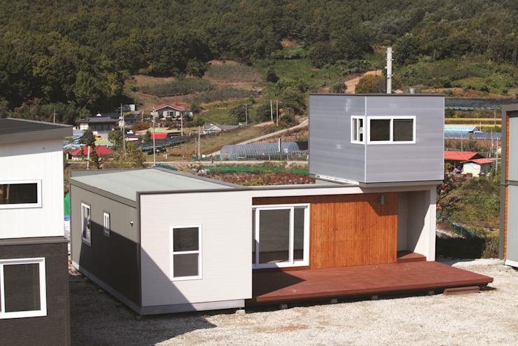 Casas de estilo moderno de 스마트하우스 Moderno
