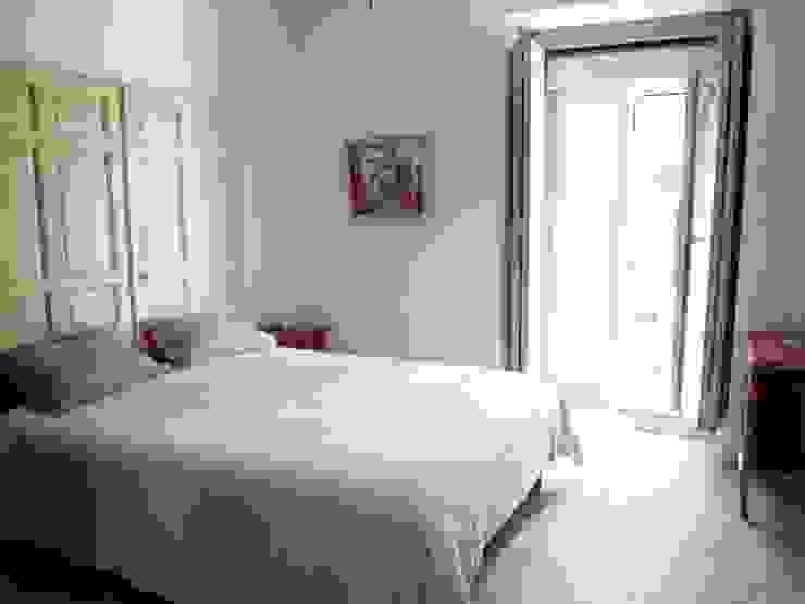Reforma integral de piso en La Latina Dormitorios de estilo ecléctico de Reformmia Ecléctico
