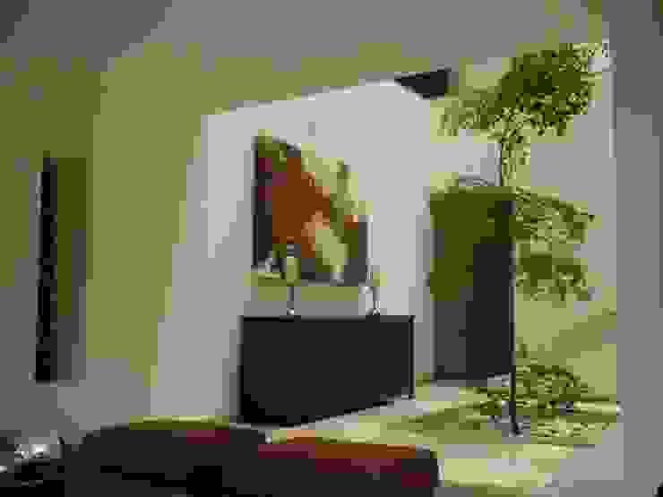 Taller A3 SC Ingresso, Corridoio & Scale in stile moderno Marmo Marrone