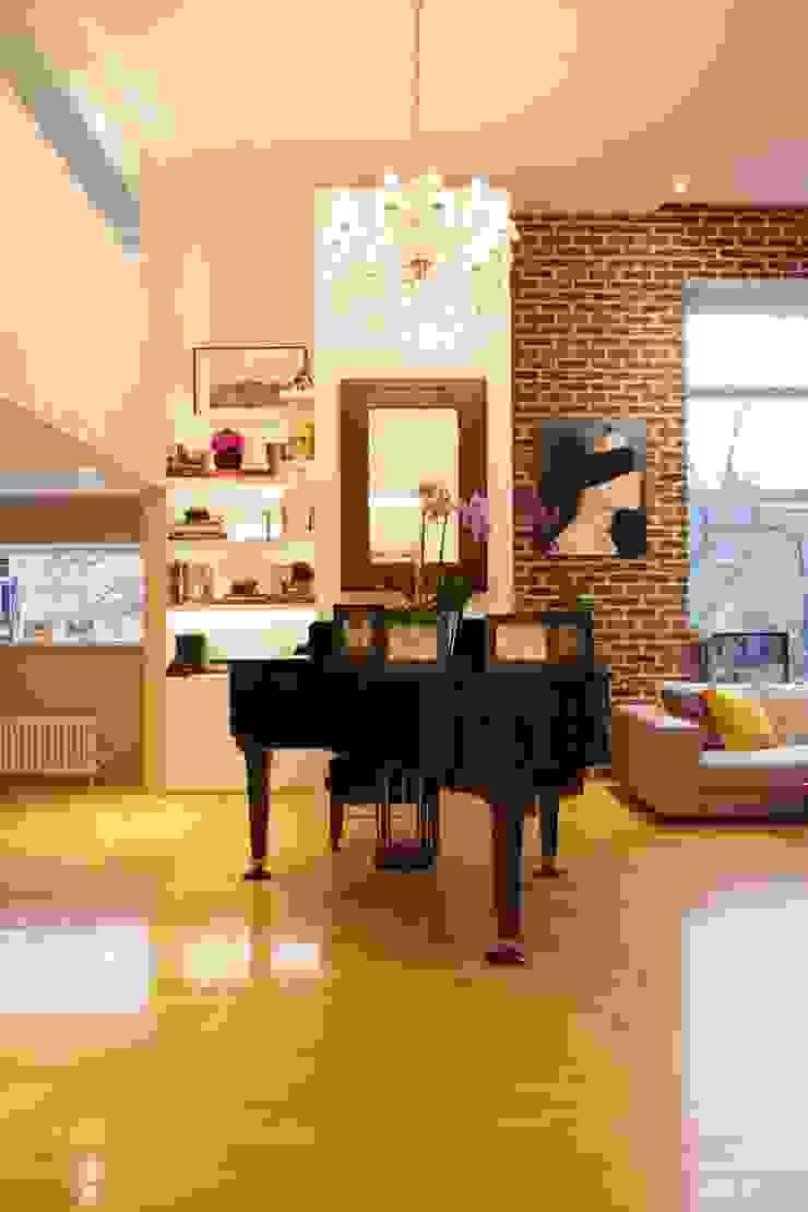 London Loft Industrial style living room by JKG Interiors Industrial Bricks