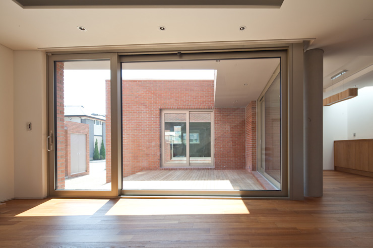 Dinding & Lantai Modern Oleh 남기봉건축사사무소 Modern