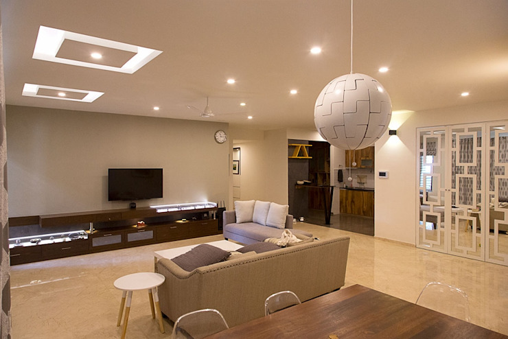 Living Area with Modern and Elegant look: modern  by Eraser IEB,Modern