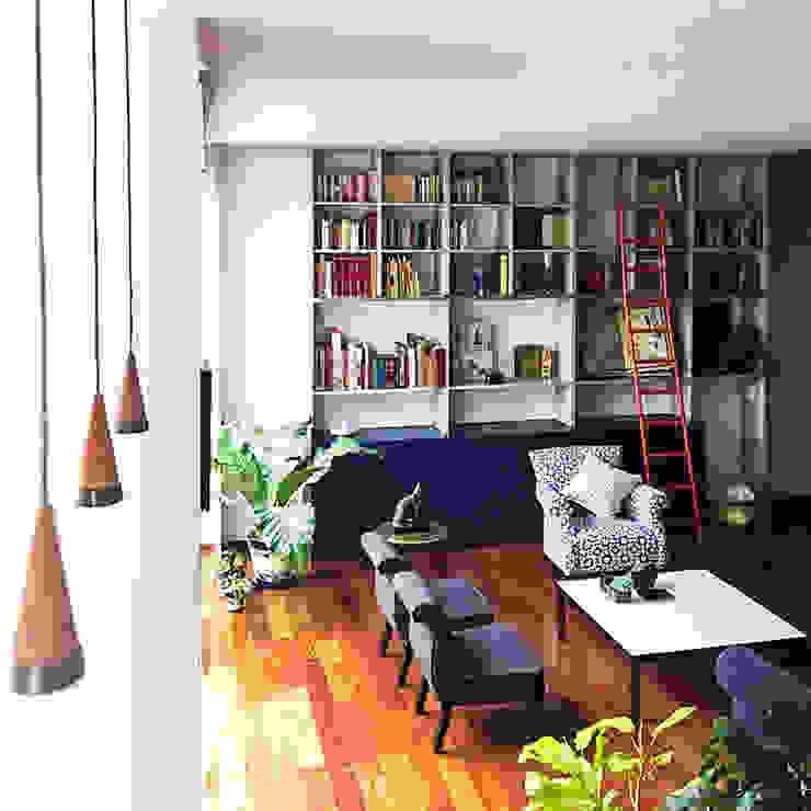 Ruang Keluarga oleh Sentido Arquitectura, Modern Perunggu