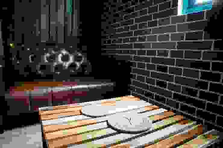 皮沙發營造復古風格: 斯堪的納維亞  by Lee Design International 空間&室內設計, 北歐風 皮革 Grey