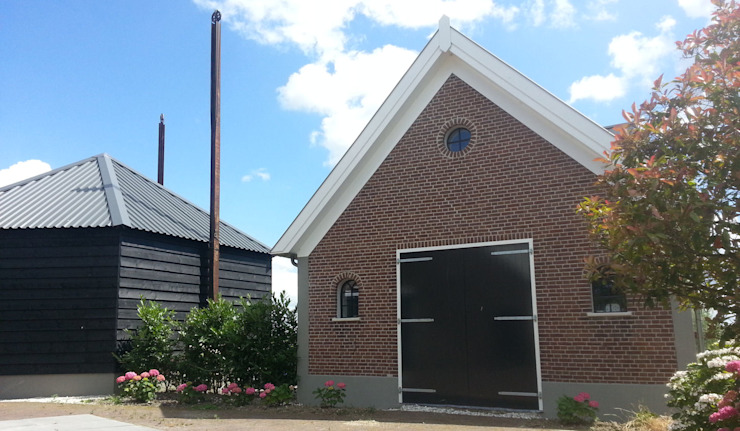 Country style house by Architectenbureau van den Hoeven b.v. Country
