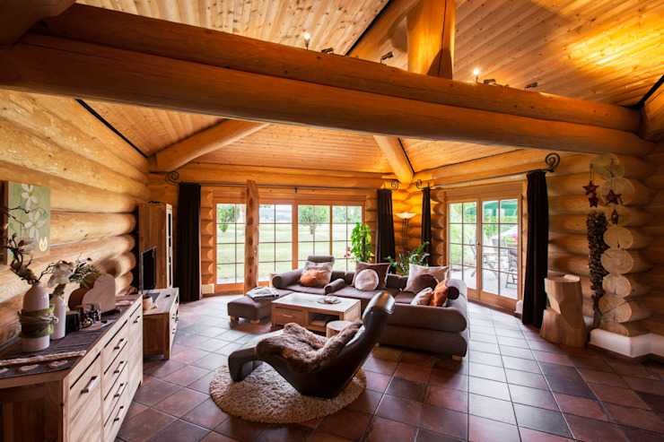Rustic style living room by das holzhaus Oliver Schattat GmbH Rustic