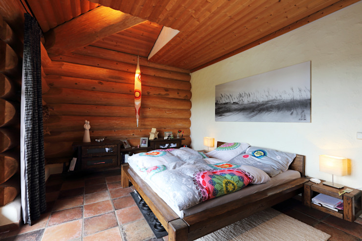Rustic style bedroom by das holzhaus Oliver Schattat GmbH Rustic