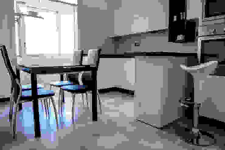 Polihouse Cucina minimalista di Luca Bucciantini Architettura d' interni Minimalista Legno Effetto legno