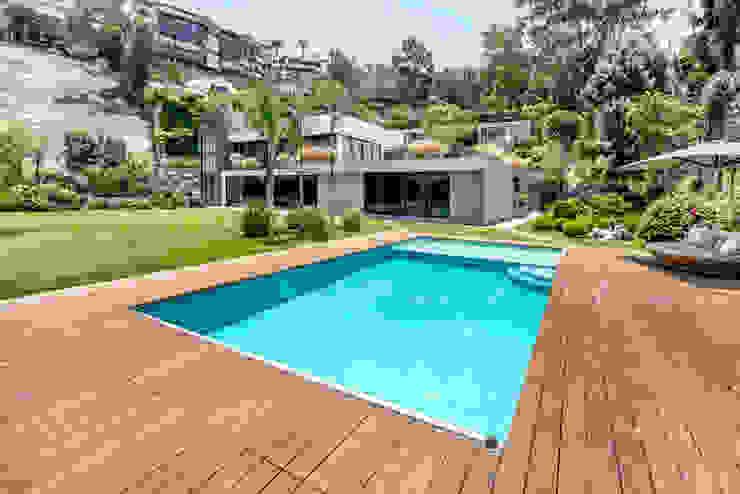 FACHADA FRONTAL Casas de estilo moderno de DMS Arquitectas Moderno