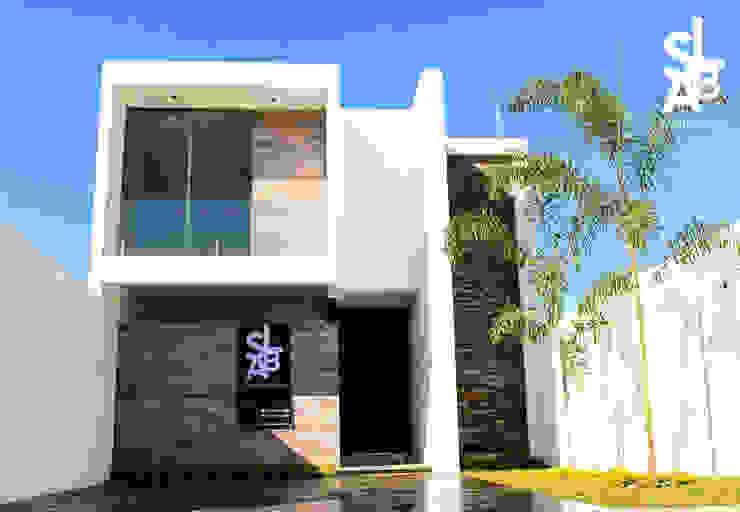 Rumah oleh Slab Arquitectos