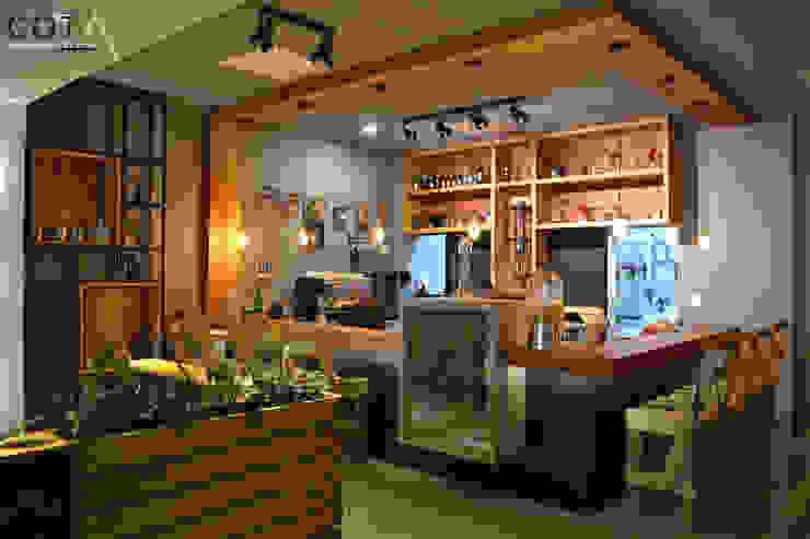 Famosta Café de COTA Arquitectura + Paisajismo Ecléctico
