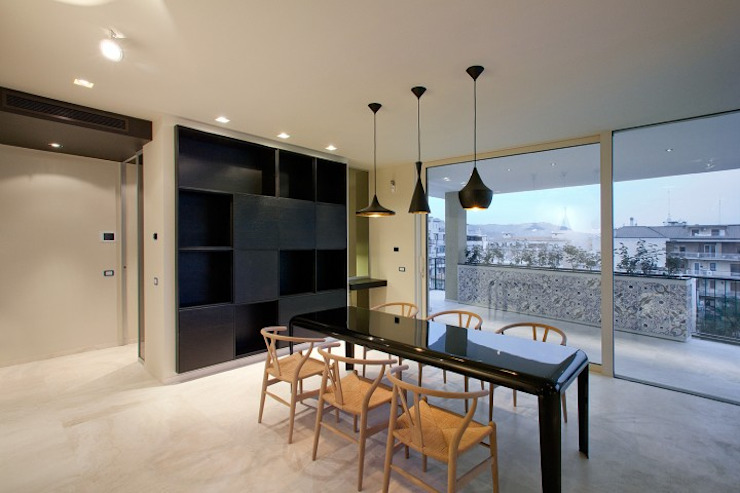 Minimalist dining room by Eusebi Arredamenti Minimalist
