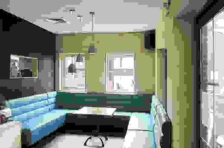 Foto 1 snackbar zithoek Moderne gastronomie van Anne-Carien Interieurarchitect Modern