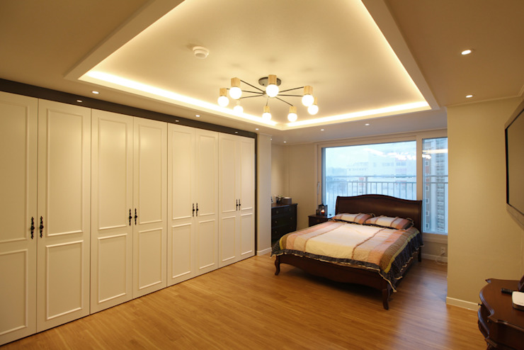 Classic style bedroom by 까사델오키드 Classic