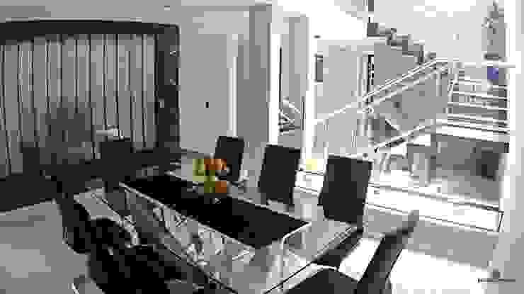 Minimalist dining room by Estudio Chipotle Minimalist