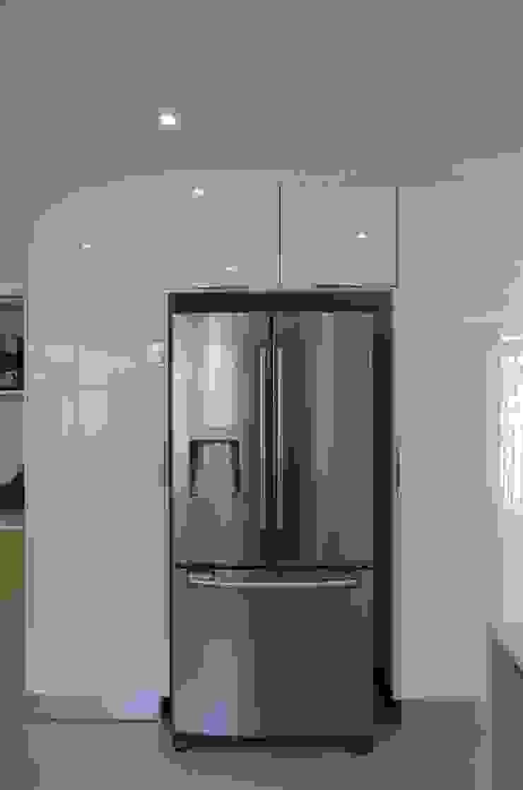 acrylic white Modern kitchen by Première Interior Designs Modern