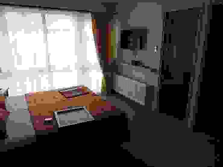 Apart Hotel Madero Dormitorios de estilo ecléctico de U.R.Q. Arquitectura Ecléctico Aglomerado