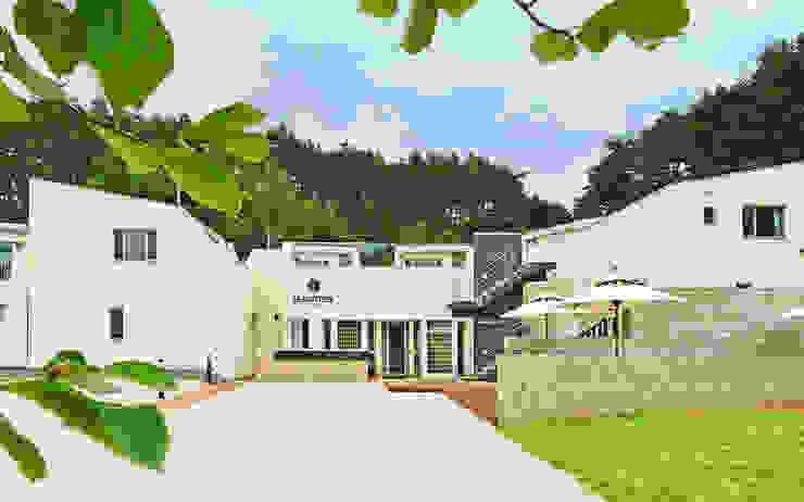Casas de estilo  por 건축사사무소 어코드 URCODE ARCHITECTURE