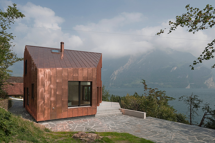 Eclectic style houses by Lüthi + Schmid Architekten BSA Eclectic Copper/Bronze/Brass