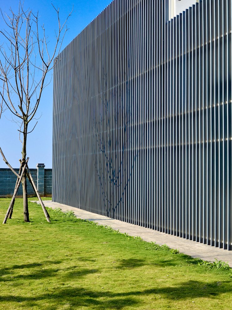 Glocal Architecture Office (G.A.O) 吳宗憲建築師事務所/安藤國際室內裝修工程有限公司 Nowoczesne domy