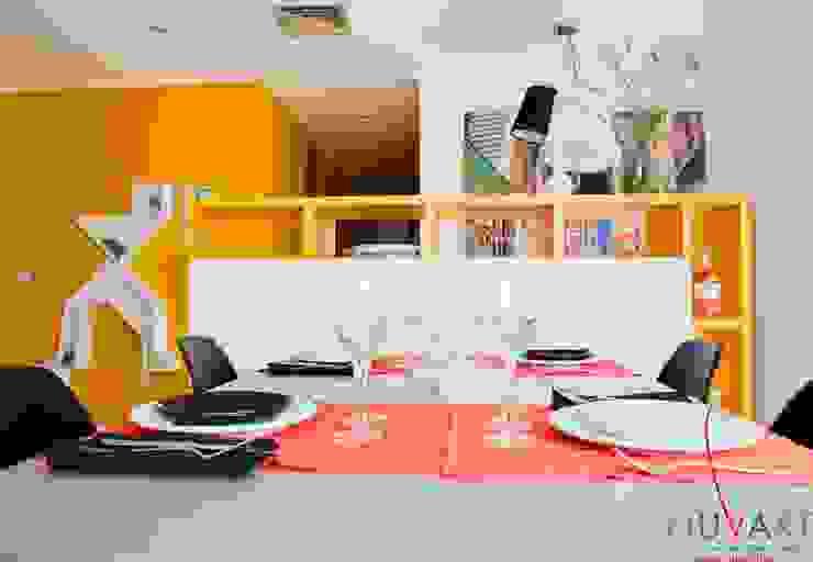 Modern dining room by NUVART Modern