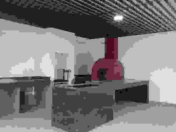 Asador y horno de piedra: Terrazas de estilo  por Mevisa Construcciones,