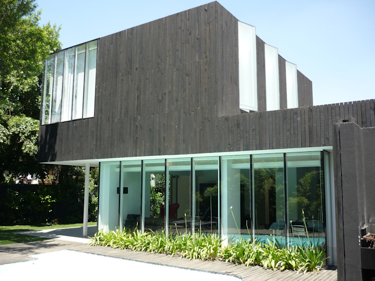 Casa Infanti Casas de estilo minimalista de Claudia Tidy Arquitectura Minimalista Madera Acabado en madera