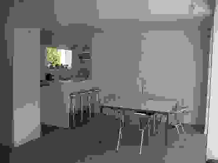 Casa Infanti Comedores de estilo minimalista de Claudia Tidy Arquitectura Minimalista