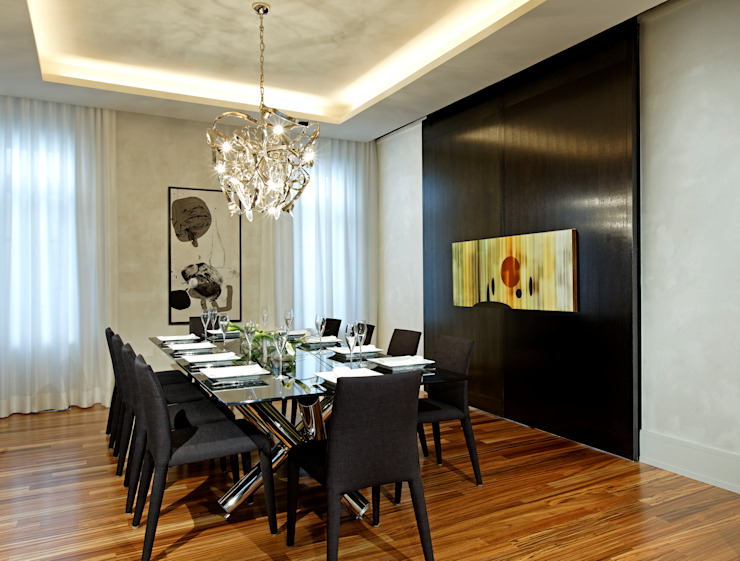 Dining Room with Doors Closed Modern dining room by Douglas Design Studio Modern