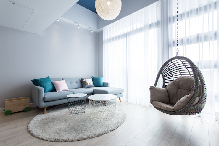 Living room by 宅即變空間微整形