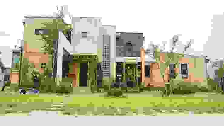 Casas estilo moderno: ideas, arquitectura e imágenes de 규빗건축사사무소 Moderno