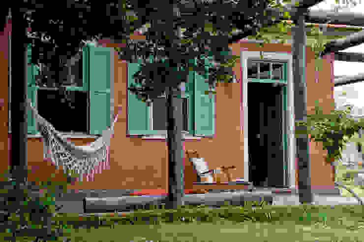 Casas de estilo  por CABRAL Arquitetos