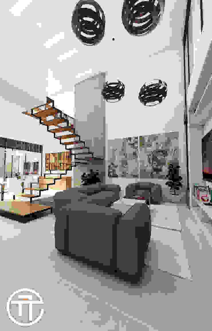 Sala de recibo en doble altura. de Attica Arquitectura