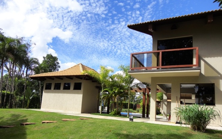 Guilherme Elias Arquiteto Country style house Wood Beige