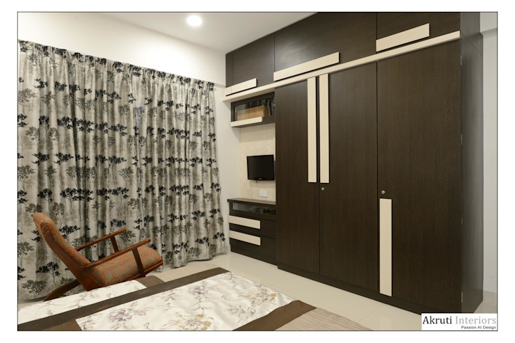 Guest Bed: modern  by Akruti Interiors Pune,Modern Plywood