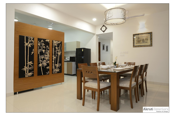 Dining room by Akruti Interiors Pune