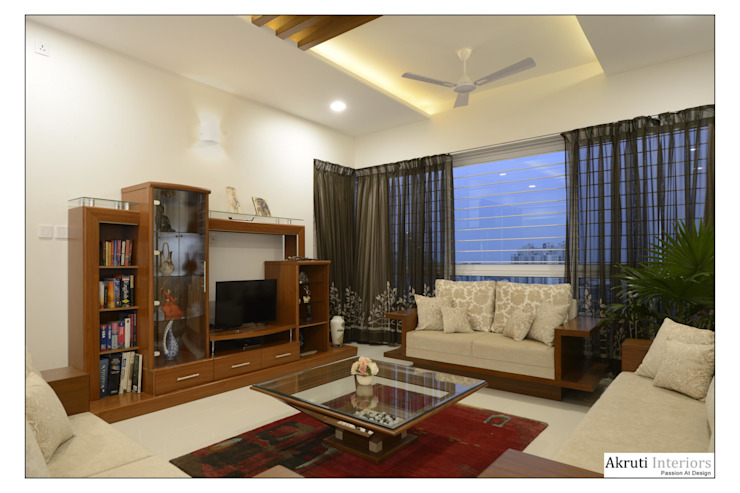 Living: modern  by Akruti Interiors Pune,Modern Plywood