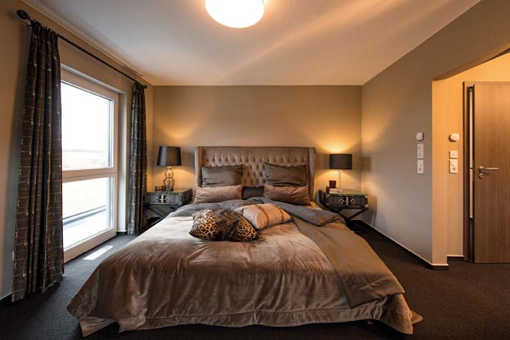 Dormitorios de estilo  de FingerHaus GmbH - Bauunternehmen in Frankenberg (Eder), Moderno