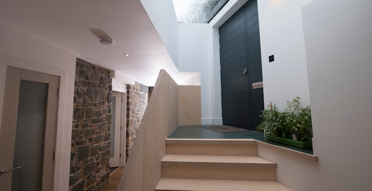 Our bespoke Plywood entrance staircase with rooflight over:  Corridor, hallway & stairs by Woodside Parker Kirk Architects,