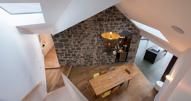 View from staircase over the dining room Modern dining room by Woodside Parker Kirk Architects Modern Stone