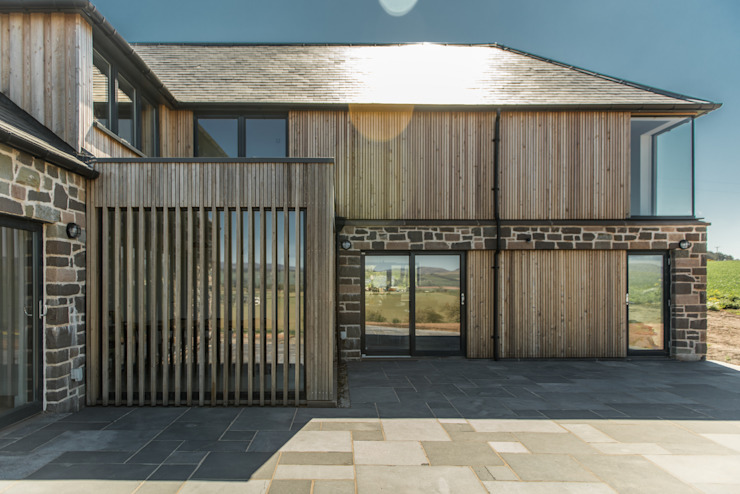 Timber and stone clad balances modern and traditional by Woodside Parker Kirk Architects Rustic